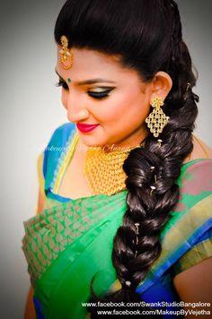 Traditional Southern Indian bride's bridal braid hair. Hairstyle by Vejetha for Swank Studio. Photo credit: Manish Ananda. Fishtail braid. Red lips. Gold earrings. Silk Saree. Sari Blouse Design. Hair Accessories. Temple jewelry. Jhumkis. Silk Kanjeevaram sari. Braid with fresh flowers. Tamil bride. Telugu bride. Kannada bride. Hindu bride. Malayalee bride. Find us at https://www.facebook.com/SwankStudioBangalore