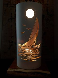 Perfect lighting solution for beach and marine themed decor.A sleek sailboat catching the wind at sunset. When lit,it throws up a spectacular silhouette against a warm ambient glow. A stunning mood light. Lampe Tube, Pvc Pipe Crafts, Stain On Pine, Pvc Projects, Mood Light, Lamp Light, Luminaire Design, Orange Background, Paper Lanterns