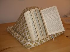 Make your own pyramid book holder.  http://www.burdastyle.com/projects/pyramid-book-holder