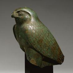 AN EGYPTIAN PERIDOTITE FIGURE OF THE HORUS FALCON, NEW KINGDOM/LATE PERIOD, 1540-30 B.C.