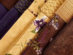 Immerse yourself in the rich hues and delicate prints of Moda's Lady Slipper Lodge collection! Featuring an indulgent palette of lavender, violet, pine green and buttercream, this lovely line showcases tonal florals, versatile daisies and elegant, embossed-effect prints. Use these pretty pre-cuts to sew a striking quilt or sophisticated decor.