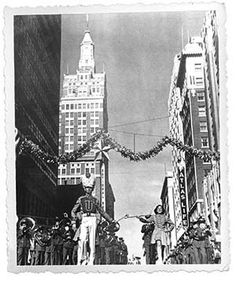 A throwback to the simpler days of one Tulsa Christmas parade: The University of Tulsa band marches south on Boston Avenue between East Fourth and Fifth streets in the 1949 Christmas parade.
