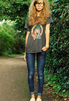 Big hair, jeans, t shirt,