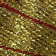 """Cloth of gold.  Cloth of gold or gold cloth is a fabric woven with a gold-wrapped or spun weft—referred to as """"a spirally spun gold strip"""". In most cases, the core yarn is silk wrapped (filé) with a band or strip of high content gold. In rarer instances, fine linen and wool have been used as the core."""
