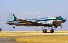 A Douglas DC-3 gathers speed as it takes off.