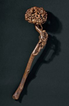 A Chinese Buddhist ceremonial sceptre (ruyi), finely carved from a bamboo root, late 18th - early 19th century.