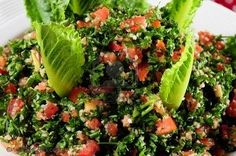Lebanese Tabouleh    3 very large bunches of fresh parsley, washed and drained  1 bunch fresh mint, washed and drained 2 scallions 1 cup finely ground bulgur wheat 4 large tomatoes 4 fresh lemons Olive oil Salt Pepper