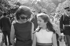 Jacqueline Onassis and Daughter Leaving Arlington Cemetery Mrs. Jacqueline Kennedy Onassis and her two children, Caroline and John Kennedy Jr., depart nearby Arlington National Cemetery after visiting the grave of President John F. Kennedy after visiting the grave of his brother Bobby on the 1 year anniversary of his death. Date June 06, 1969