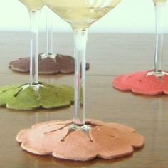 coasters for glasses: double layered felt, with a flower or star cut out of the top layer to insert the base of your glass.