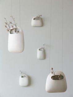 white ceramic hanging vases