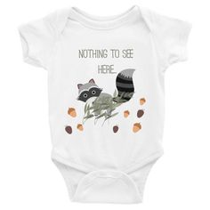 Nothing To See Here Baby Onesie ($26 AUD) available in white, black, grey, and navy from sizes 3-24 months.