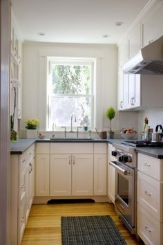 Paint cabinets the same color as the walls. Limiting the cabinetry and the wall color to a single hue erases visual boundaries that might stop the eye. The conventional school of thought is that pale colors will reflect light and make the space feel bigger