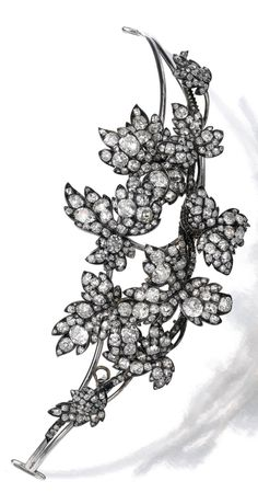 An antique diamond tiara, late 19th century. Designed as interweaving branches, set with cushion-shaped, circular-cut and rose diamonds, three leaves and three branches detachable, accompanied by brooch and ear clip fittings. #antique #tiara