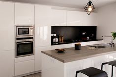 This is an example of a contemporary kitchen.Inspiration for a contemporary kitchen.Design ideas for a contemporary kitchen.Design ideas for a mid-sized contemporary galley eat-in kitchen with flat-panel cabinets, white cabinets, black backsplash, stainless steel appliances, light hardwood floors and an island.Contemporary home design.Design ideas for a large contemporary open concept living room with white walls, medium tone hardwood floors, no fireplace and a freestanding tv.Inspiration…