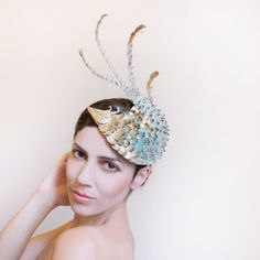 Maor Zabar, costume designer and artist based in Tel Aviv. A unique dragon bird shaped cocktail hat, covered by handmade scales coated with gold leafs.