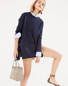 """J.Crew women's merino cotton oversized tunic sweater, Thomas Mason® for J.Crew collarless tuxedo shirt in stripe, 3"""" stretch chino short, Poppy drop earrings, Dragon Diffusion small tote bag and ankle-strap sandals in calf hair."""