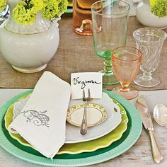 Style Tip: Layer shapes and colors by combining plates and glasses of different hues and sizes in one place setting. | Get the Look: Dinner Plate in Blue and Salad/Dessert Plate in Green from the Southern Living Collection through Ballard Designs; ballarddesigns.com.