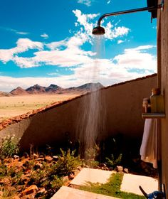 Sossusvlei Desert Lodge, Namibia    The Shower: Cool off in the afternoon in the outdoor shower and take in vistas of the awe-inspiring dunes and stony outcrops rising against an endless blue sky. Keep the pocket telescope (stocked in all rooms) handy to spot ostriches or kudus.