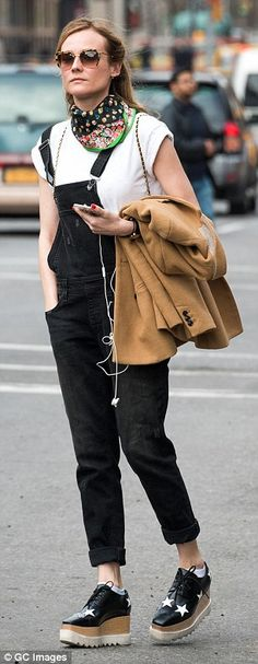 Comfy yet cool: Diane Kruger, 39, looks stylish in a pair of Big Star overalls as she hailed a cab in New York City last week.