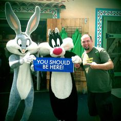 Bugs Bunny and Sylvester pose with the You Should Be Here banner #dreamtrips #ysbh #famous