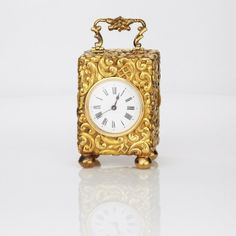 Gold repouseé miniature carriage clock french with back winder 165gms 15ct gold