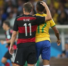 Embrace: Miroslav Klose, who grabbed the second for Germany, consoling Luis Gustavo.Julio 8/14