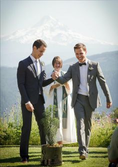 Same-sex wedding. The officiant looks equally as thrilled as the grooms! :) #grooms #gay #wedding