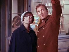 """Star Trek: """"The City on the Edge of Forever"""". With Joan Collins, pictured here. Written by Harlan Ellison & considered by many to be the best single episode of a series whose popularity & relevance endures some 50 years on.  Kirk points to a faint star in Orion's belt. """" 'Let me help' – A hundred years or so from now, I believe, a famous novelist from a planet orbiting that star will write a classic using that theme. He'll recommend those three words even over 'I Love You' """"."""