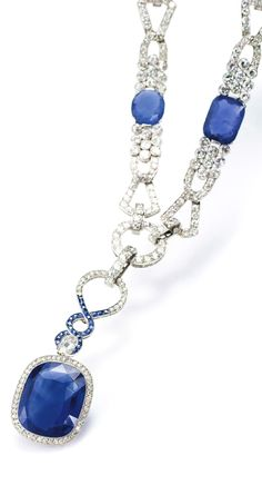 AN EARLY 20TH CENTURY SAPPHIRE AND DIAMOND PENDANT TOGETHER WITH AN ART DECO SAPPHIRE AND DIAMOND NECKLACE, BY LUIS SANZ circa 1920