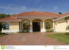 Neat Yellow and White House. Neat yellow home with white columns, red tile roof , Best Exterior Paint, House Paint Exterior, Exterior Paint Colors, Exterior House Colors, Paint Colors For Home, Cottage Exterior, Spanish Revival Home, Spanish House, Spanish Tile