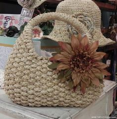 Perhaps woven straw bags and hats with over-sized flower a must-have for Spring, courtesy of @loic bizel