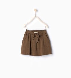 Image 1 of Skirt with bow from Zara Little Fashion, Kids Fashion, Short Niña, Cool Kids Clothes, Kids Clothing, Skirts For Kids, Zara Skirts, Girl Falling, Girls Sweaters