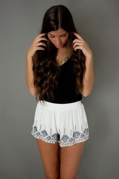 Cute shorts and I love her hair.