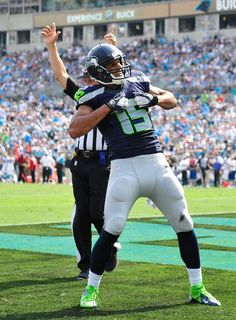 Jermaine Kearse of the Seattle Seahawks celebrates against the Carolina Panthers after scoring the game-winning touchdown during the fou. Seahawks Players, Seahawks Gear, Seahawks Fans, Seahawks Football, Nfl Football Teams, Broncos Fans, Best Football Team, Seattle Seahawks, Football 2013