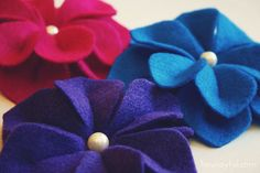 flowers made out of felt ~ *ahem* oh miss @Katie Noblitt look at these....in felt...aren't the colors fun and imagine  all the colors available/possiblities and how easy felt would be to manipulate..hint, hint, hint....wink, wink☺