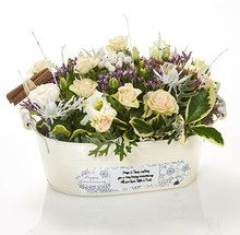 """Celebrate another year of happiness with our personalised keepsake flower trough, awash with colourful blooms to release delicious scents every time your love sweeps by. So, what's your special message to add to our pre-printed """"Happy Anniversary"""" swing tag? """"Happy Anniversary"""" will be printed on the label as well as your personal message."""