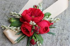 This ribbon tied wrist corsage features red piano garden roses, willow eucalyptus and pieris japonica Homecoming Flowers, Prom Flowers, Bridal Flowers, Homecoming Corsage, Red Corsages, Flower Corsage, Wrist Corsage Wedding, Wedding Bouquets, Corsage And Boutonniere