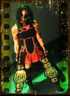 The Decay's Rosemary holding Tag Team belts.
