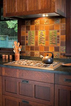 Love the quarter sawn wood Stunning ~ In an Arts Crafts Revival kitchen, an artistic tile panel by Handcraft Tile Co. and oak cabinets lend appeal to a kitchen with modern appliances. Photo by William Wright. Mission Style Kitchens, Kitchen Tile, Kitchen Remodel, New Kitchen, Home Kitchens, Craftsman Kitchen, Kitchen Styling, Kitchen Tiles, Classic Kitchens