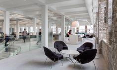 Clean open space and Knoll Womb Chairs at MITHUN - Minneapolis Offices