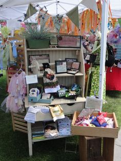 Great way display at a craft sale! We love our vintage hutch/gardening table to display our variety of goodies!