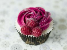 Rose & Raspberries Cupcake-- to make rose, frost in swirl pattern with closed star tip (eg: Wilton 2D drop flower tip)