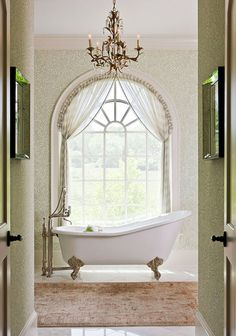 A master bath dressed in green is flooded with natural light - Traditional Home® / Photo: Gordon Beall / Design: Anne Page #thehighboystyle
