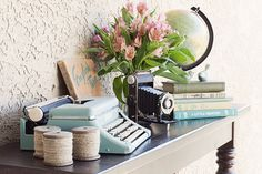 This is actually a photography post, but I had to pin this picture because the styling of this table is so me (different flowers though).  Love the old typewriter, camera, globe, and books!  Should use it for ideas on my LR table.