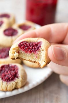 Raspberry thumbprint cookies are easy gluten free and low carb cookies with a fruity raspberry jam filling. They are perfect for low carb, Keto and sugar free diets.