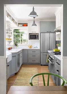 Lots of light, a cool color palette, and vastly improved flow make this galley-style kitchen feel spacious and inviting.