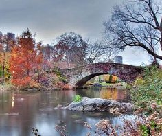 Couples stroll hand-in-hand across the #romantic Gapstow Bridge in #NYC's Central Park.
