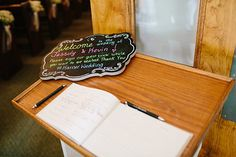 Chalkboard sign to welcome wedding guests. Used colorful chalk pens/markers.
