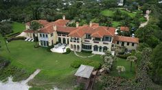 39 Beach House Designs from Around the World Aerial view of large Florida beach mansion with extensive grounds