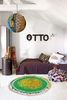 Adorable kids room, love the colors, pillows, name on the wall, and visible texture!